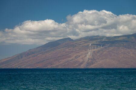 Modern windmills on the Hawaiian island of Maui generating clean energy