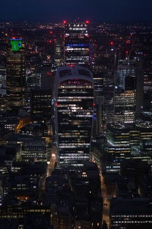 Aerial skyline view at of Londons famous business district with skyscrapers and offices at night