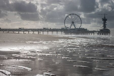 Low angle view of pier of Scheveningen with ferris wheel and bungee tower, the Netherlands