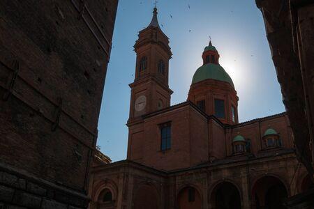 Church of San Bartolomeo Gaetano in Bologna, Italy next to the two towers (due torri Asinelli and Garisenda)