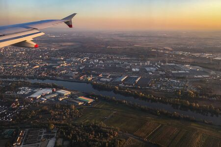 Aerial view of Ruesselsheim and Opel-Werk with main river, sunset against blue sky