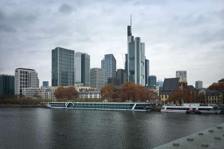 Frankfurt am Main, Germany - November 26, 2018: Cityscape with several bank buildings such as Commerzbank and river Main against sky