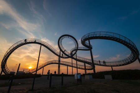 Duisburg, Germany – August 28, 2018: Walkable Tiger & Turtle roller coaster sculpture on Magic Mountain. The construction is a gangway with steps and part of industry culture