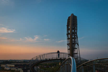 Duisburg, Germany – August 28, 2018: Fragment of walkable Tiger & Turtle roller coaster sculpture on Magic Mountain. The construction is a gangway with steps and part of industry culture