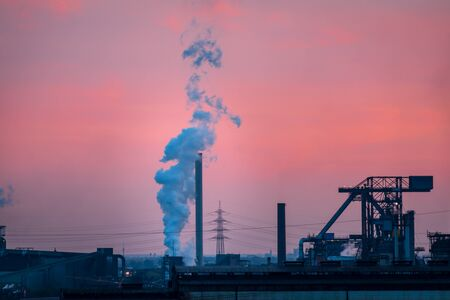 Scenic view of industrial landscape of ruhr area in Germany at sunset against colorful sky