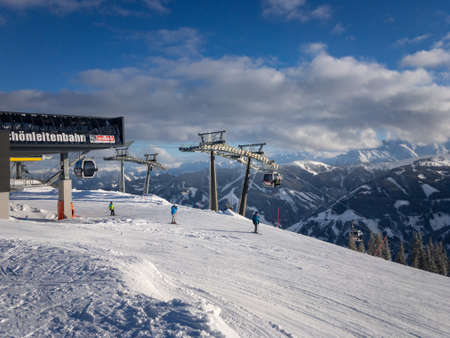 Vorderglemm, Austria – January 29, 2019: Arrival of Schönleiten cable car ski lift in the region of Saalbach-Hinterglemm against blue and cloudy sky
