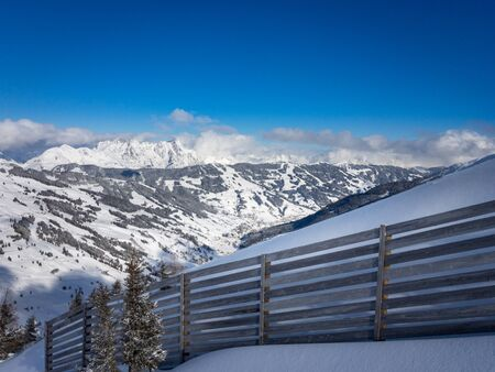 Scenic view of snow covered mountains in the ski region of Saalbach Hinterglemm in the Austria alps against blue sky