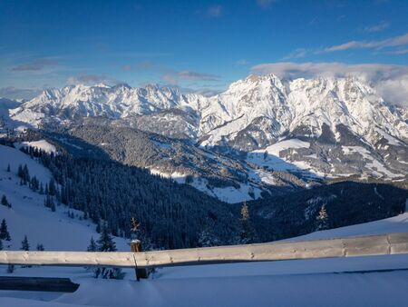 Scenic view of snow covered Leogang mountains (right) and Lofer Mountains (left) in the Austrain alps against blue sky