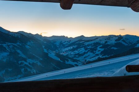 Scenic view of snow covered mountains in the ski region of Saalbach Hinterglemm in the Austria alps against clear sky at sunset
