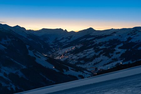 Scenic view of snow covered mountains in the ski region of Saalbach Hinterglemm in the Austria alps by night