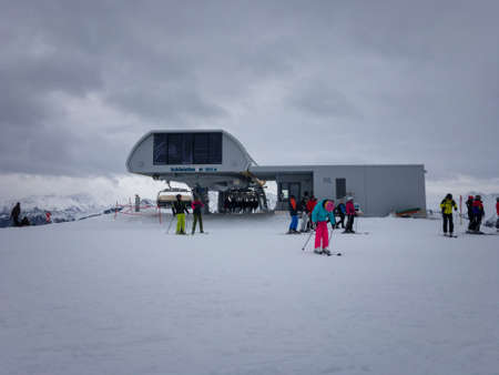 Vorderglemm, Austria – January xx, 2019: Arrival of Schönleiten chairlift in the ski region of Saalbach-Hinterglemm against cloudy sky