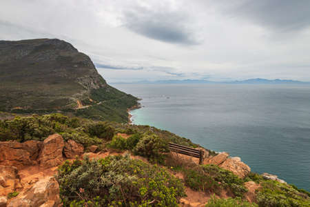 Scenic view to False Bay from Cape of Good Hope nature reserve, South Africa against cloudy sky