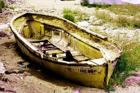 old boat on old coast