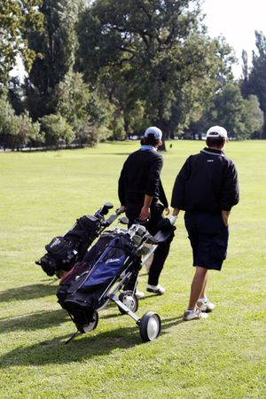 two man on golf field Stock Photo
