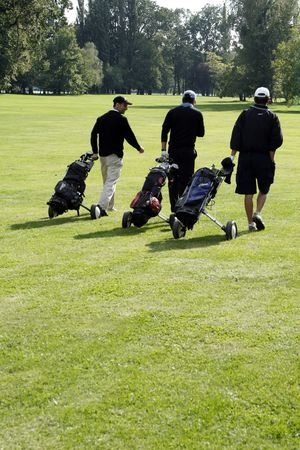 three man who playing golf  Stock Photo
