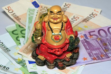 happy buddha on the money