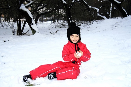 Little girl in the snow Stock Photo