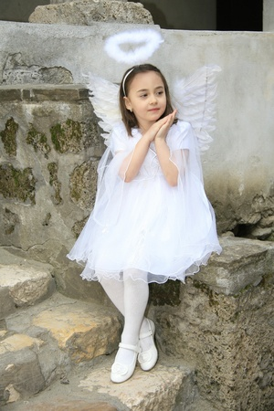 girl dressed as an angel photo