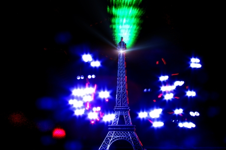 Light paint-Mini tower Eiffel lighted with laser and another sources