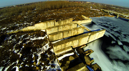 Aerial photo with a frozen lake and a lock