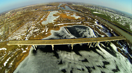 Aerial photo - isolated bridge over a frozen lake