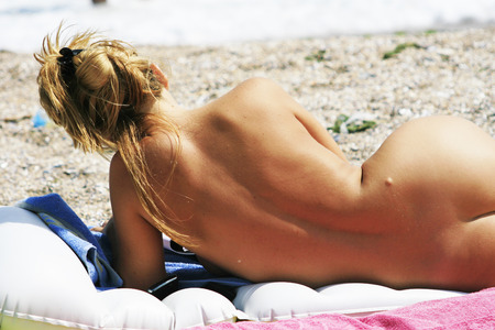 Relaxing nude women on the beach