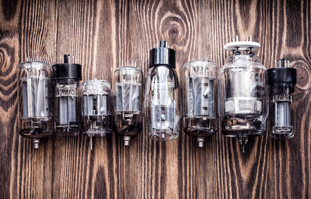 different generations of electronic vacuum tubes. closeup view