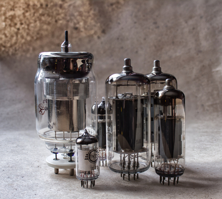 vertical composition of vacuum tubes on kraft paper. vintage electronic background Stock Photo