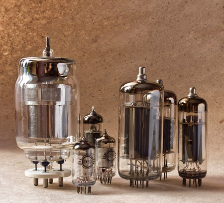 composition of different electronic vacuum tubes on kraft paper background.