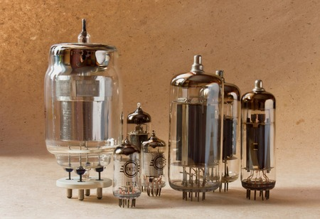 composition of electronic vacuum tubes on kraft paper background.