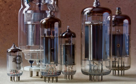 close up view of different vintage electronic vacuum tubes in bi colors. Stock Photo