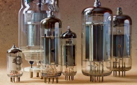 macro shot of old radio lamps on kraft paper background in bi colors.
