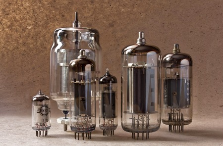 amp: electronic background with vacuum tubes on kraft paper.