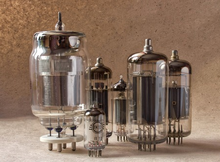 composition of different vintage electronic vacuum tubes.