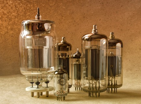composition of different tipes electronic vacuum tubes in warm tones.