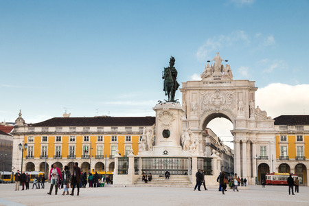 augusta: Lisbon, Portugal february 18, 2014: Triumphal arch connecting the Commerce Square to the Augusta Street. It has a clock and statues of Viriatus, Nuno lvares Pereira, Vasco da Gama and Marquis of Pombal