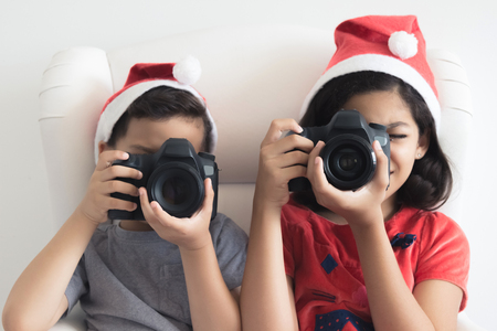 girl glasses: Taking pictures at Christmas Stock Photo