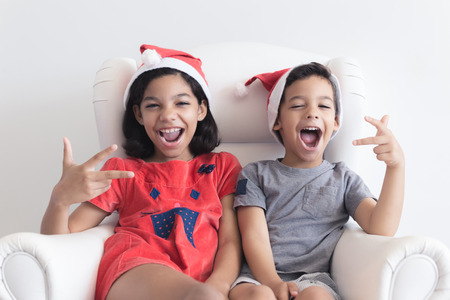 a boy: Boy and girl celebrating Christmas