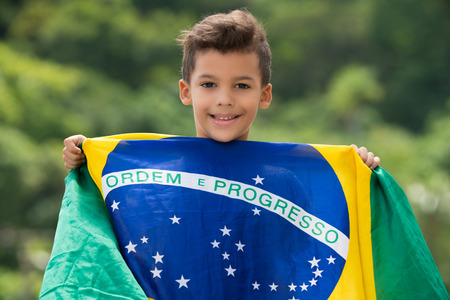 Patriot  Happy child holding the Brazils flag