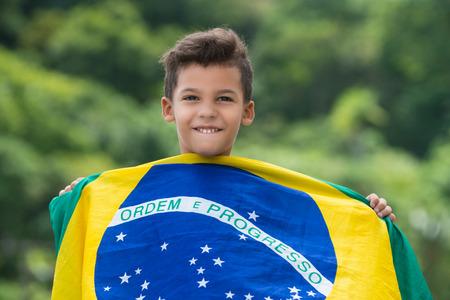 patriot: Patriot  Happy child holding the Brazils flag