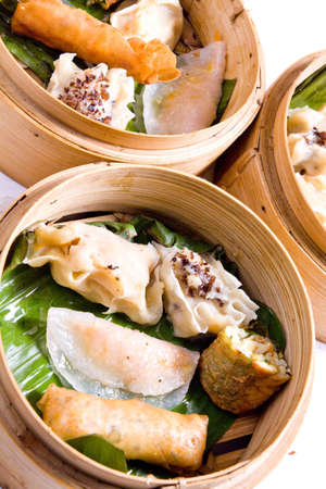 Dimsum selection in bamboo steam containers photo