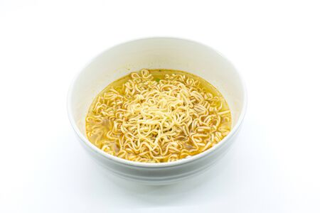 Famous asian instant noodles isolated in a ceramic bowl on white background. Horizontal shot. Stock fotó