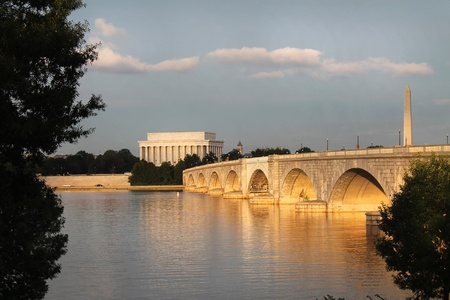 View of the Lincoln Memorial, Washington Monument and Memorial Bridge from the banks of the Potomac River, Sundown Washington DC  photo
