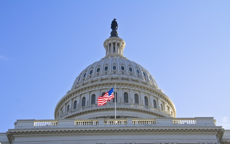 The flag of the USA flying in front of the Capitol dome in Washington, DC   photo