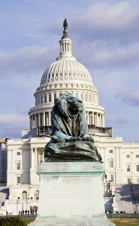 The lion sculpture with US Capitol background  photo