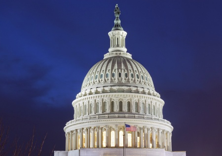 US Capitol Building Dome detail with American Flag, at dusk, Washington DC, United States photo
