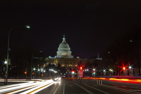 the capitol: Capitol seen from Pennsylvania Avenue  Night time with traffic rushing by