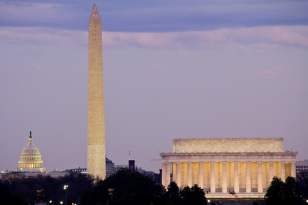 View of Washington DC with Capitol, Washington Monument and Lincoln Memorial in line, at dusk  Stock Photo