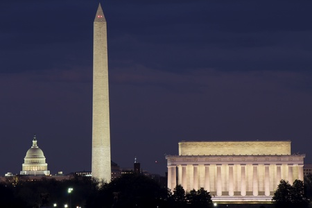 downtown capitol: View of Washington DC with Capitol, Washington Monument and Lincoln Memorial in line, at dusk  Stock Photo