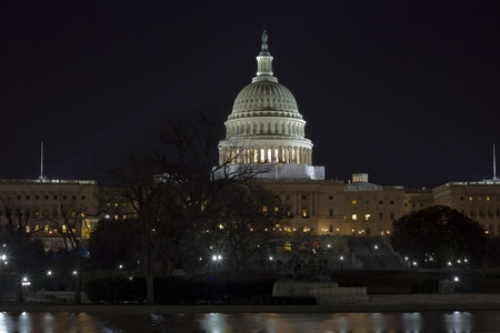 Capitol hill building at night illuminated with light, Washington DC   photo